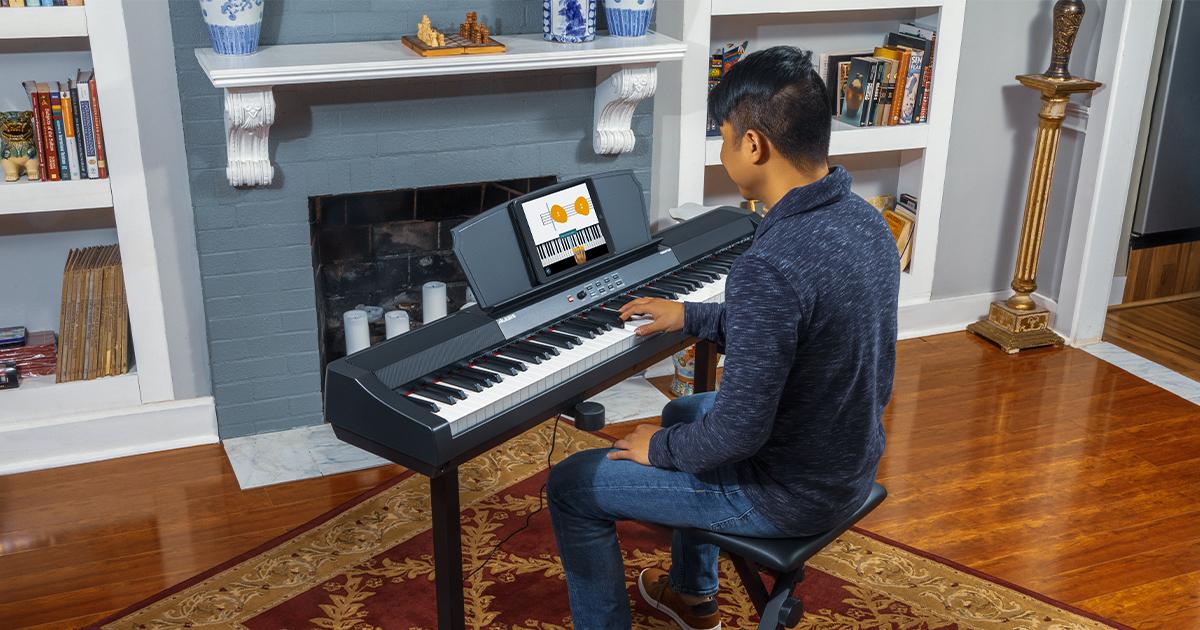 Alesis Prestige pianoforte digitale con tastiera 88 tasti a pesatura graduale, 16 suoni multicampionati, modalità Split, Layer, Lesson e Record, metronomo, con casse integrate 50W e USB MIDI